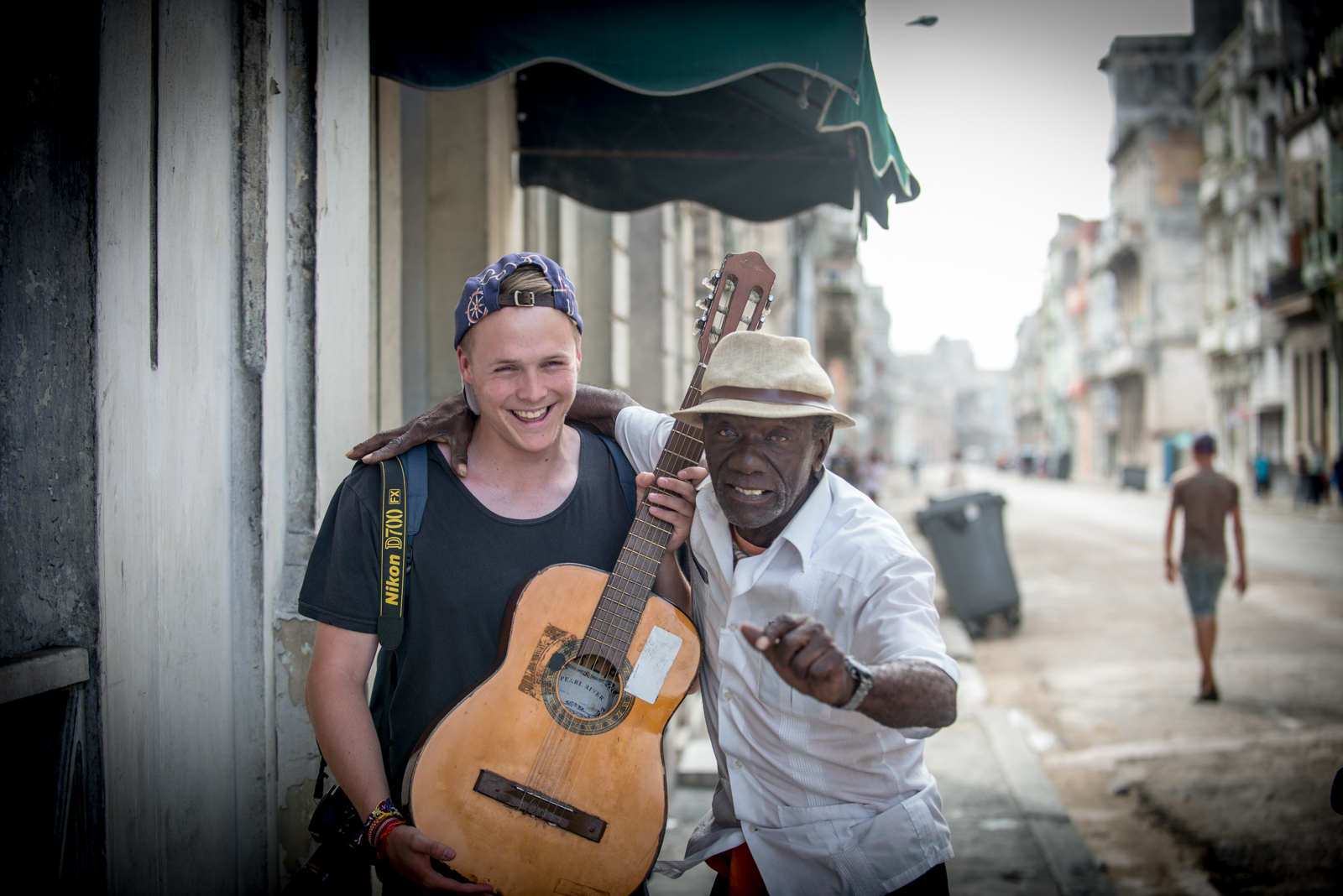 playing guitar in Havana
