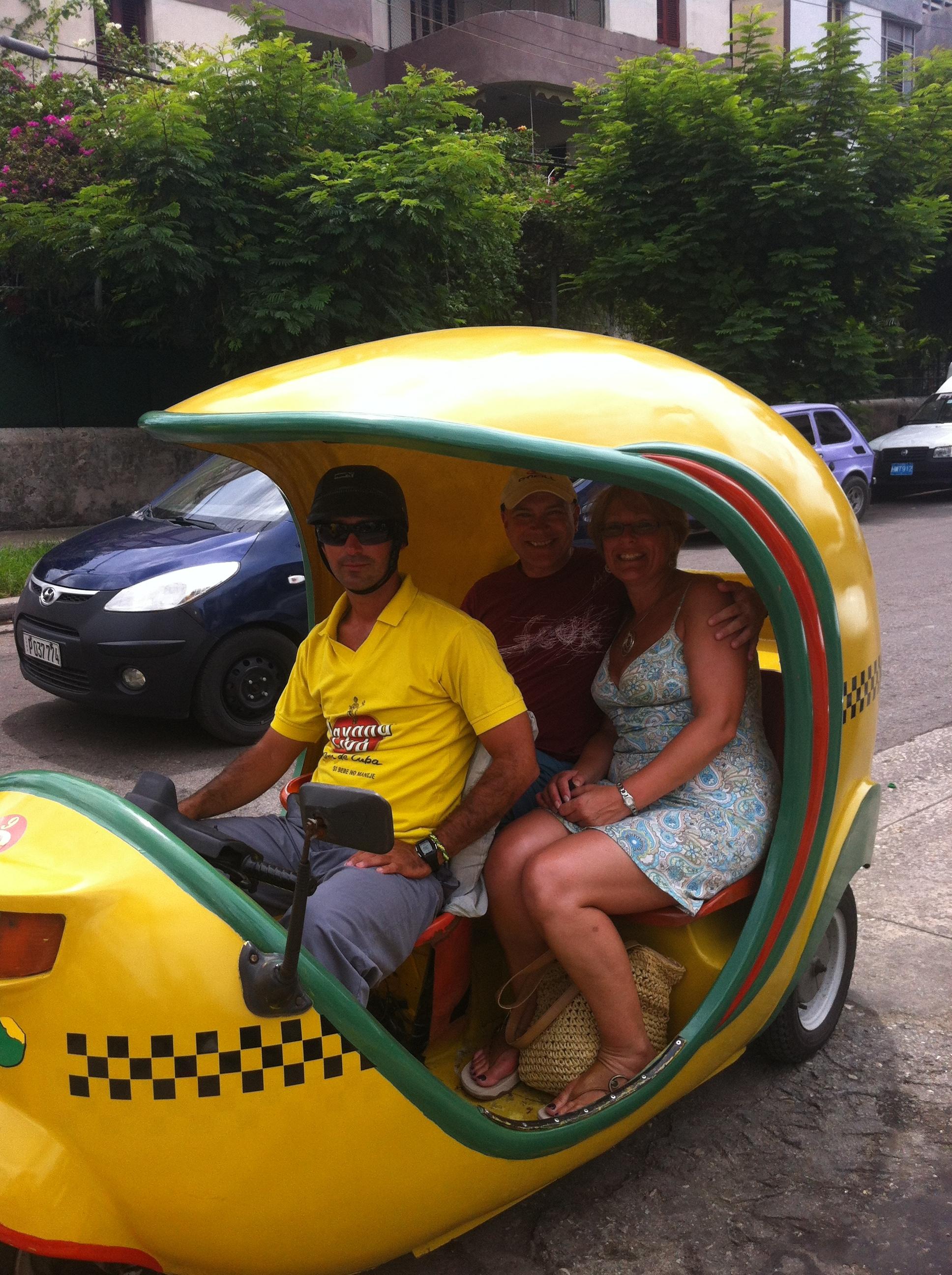 Enjoy a coco taxi city tour